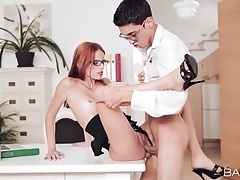 Secretary sits on the desk for a hardcore fuck tubes