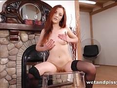 Sexy redhead has fun peeing on the floor tubes