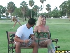 Hot blonde in body paint in a public park tubes