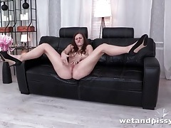 Leggy babe in heels looks hot fucking a toy tubes