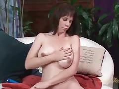 Mom sensually rubs lotion into her big tits tubes