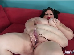 Babe with big belly rolls vibes her shaved cunt tubes