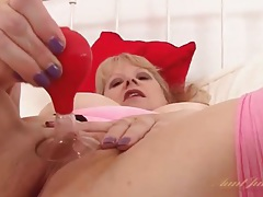 Solo mature babe in stockings toys her tight cunt tubes