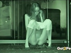 Tall and skinny girl pees in night vision footage tubes