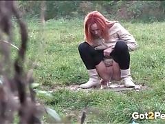 Redhead in leggings filmed peeing in public tubes