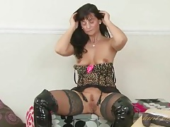Black leather and leopard print lingerie on a hot mom tubes