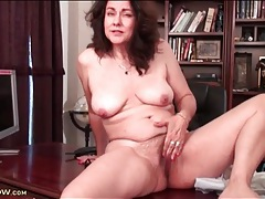 Legs open to show off her hairy mature cunt tubes