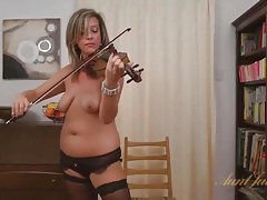 Cute milf in a lingerie set spreads her cunt lips tubes