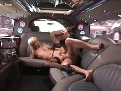Slut orally services a businessman in a limo tubes