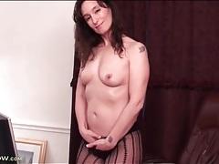Milf striptease to her smoking hot black pantyhose tubes
