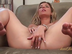 Luscious babe with her legs open rubs that hot cunt tubes