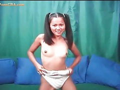 Petite asian teen sweetheart in pigtails strips tubes