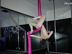 Sporty ribbon dancing with a gorgeous naked teen tubes