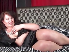 Chubby mature gal is sexy in a satin skirt tubes