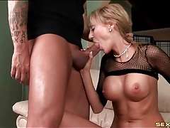 Mom with hot fake tits sucks on a thick dick tubes