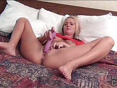 Blonde amateur and her dildo play in the hotel tubes