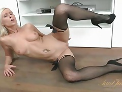 Stockings with black satin bows on a perfect blonde tubes