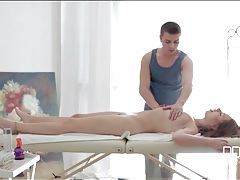 Masseur erotically works fingers into her pussy tubes