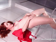 Redhead unties her sexy robe to piss erotically tubes
