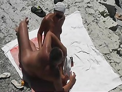 Quick handjob on the beach from his lovely wife tubes