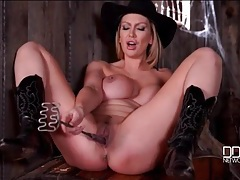 Cowgirl shoves a cattle brand in her pussy tubes