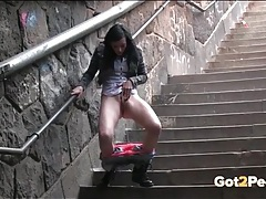Jeans and panties girl pees on the public stairs tubes