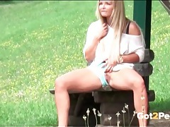 Chick sitting on a bench takes a long piss tubes