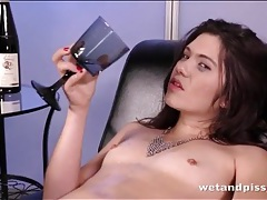 Hairy girl sips her piss from a wine glass tubes