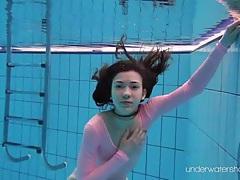 Leggy girl goes swimming in her leotard tubes