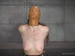 Girl in a rubber mask and bondage whipped on her tits tubes