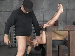 Throat and cunt of a babe in bondage gets laid tubes