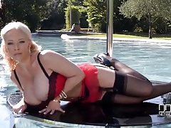 Massive tits milf wears lingerie in the pool tubes