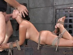 Bitch bound by rope opens up for face fucking tubes