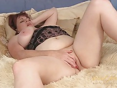 Chubby mature sucks her tits and masturbates solo tubes