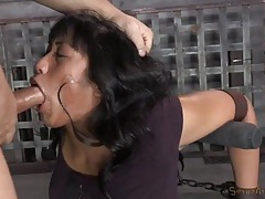 Face fucked girl is bound by leather straps tubes