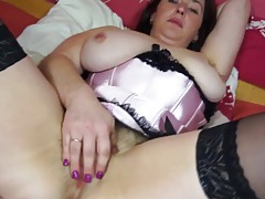 Hairy mature chick in satin lingerie rubs her vagina tubes