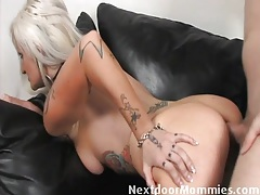 Platinum blonde milf with sexy tattoos loves anal tubes