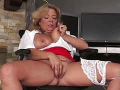 Secretary sits at her desk and rubs mature pussy tubes