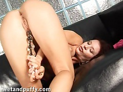 Chick with sexy cunt lips masturbates with a toy tubes