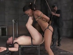 Slave girls fuck each other with a strapon tubes