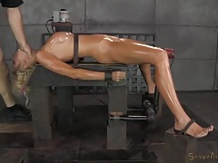 Slave girl coated in oil and fucked down the throat tubes