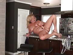 Naked mature housewife masturbates in her kitchen tubes