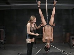 Punished black girl hangs upside down in the dungeon tubes
