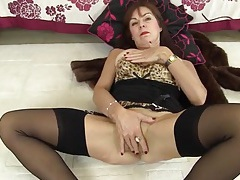 Old lingerie model fucks her snatch with a dildo tubes