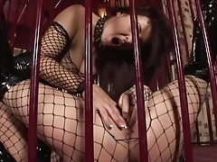 Lesbians in a cage fuck in fishnets and boots tubes