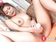 Asian girl plays with her clitoris in close up tubes