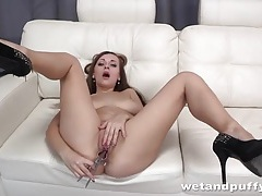 Long legged girl in high heels has fun with toys tubes