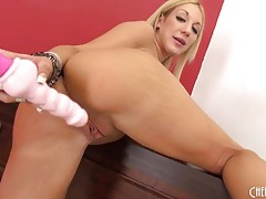 Fake boobs chick in heels toys her tight pussy tubes