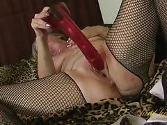 Huge red dildo fucks deep into her mature pussy tubes