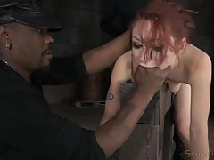 Redhead bound in the whore position and used hard tubes